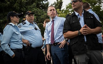 Public Security Minister Gilad Erdan, center, with police forces at the annual Gay Pride Parade in Jerusalem, June 6, 2019. (Yonatan Sindel/Flash90)