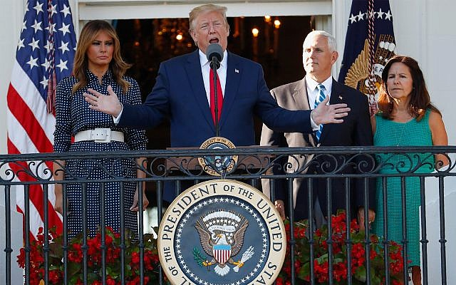 US President Donald Trump, with first lady Melania Trump, left, and Vice President Mike Pence, right, and his wife Karen, speaks from the Truman Balcony of the White House during the annual Congressional Picnic on the South Lawn June 21, 2019. (AP Photo/Jacquelyn Martin)
