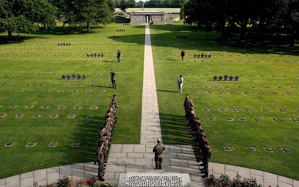 German soldiers stand during a moment of remembrance in the German cemetery of La Cambe, in Normandy, France, June 3, 2019. (AP Photo/Thibault Camus)