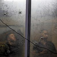 Bullet holes at the Palestinian Authority security apparatus headquarters in Nablus, a result of an accidental firefight between IDF troops and PA security personnel, June 11, 2019. (JAAFAR ASHTIYEH / AFP)