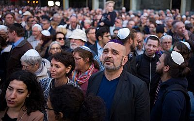People wear kippahs during a demonstration against anti-Semitism in Berlin, April 25, 2018. (AP Photo/Markus Schreiber)