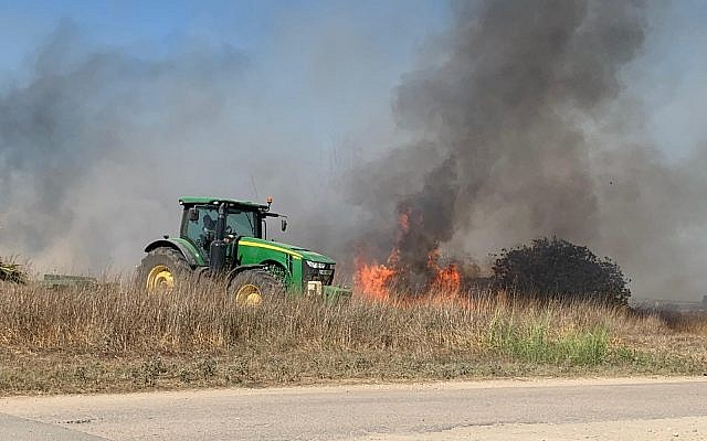 A fire caused by an incendiary device from the Gaza Strip rages in an agricultural field in the Sha'ar Hanegev region of southern Israel on June 27, 2019. (Sha'ar Hanegev regional council)