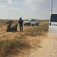 Police sappers deal with a suspected explosive device found in a field in the Eshkol Regional Council on June 28, 2019. (Eshkol Regional Council)