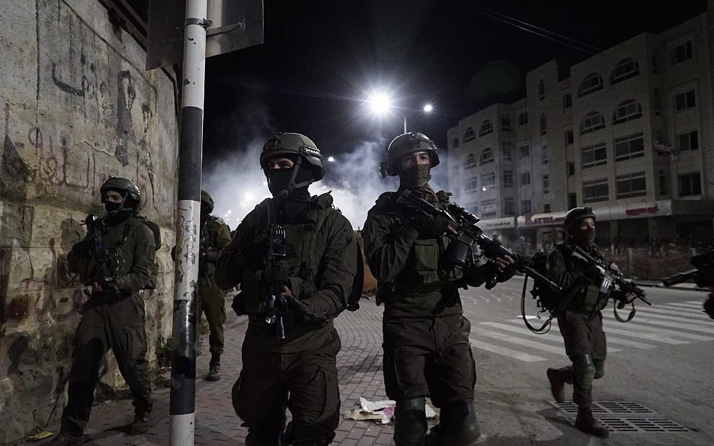 IDF arrests 19 Palestinian suspects in overnight West Bank raids