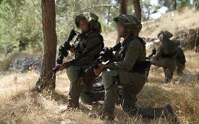 Israeli soldiers participate in a large-scale exercise simulating warfare against the Hezbollah terror group in Lebanon, in June 2019. (Israel Defense Forces)