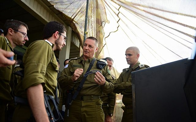 The head of the IDF Teleprocessing Corps Maj. Gen. Yitzhak Turjeman speaks to officers during a large-scale exercise simulating warfare against the Hezbollah terror group in Lebanon, in June 2019. (Israel Defense Forces)