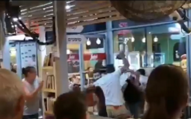 A brawl filmed at a pancake house north of Netanya, June 15, 2019 (video screenshot)