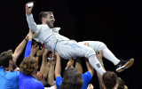 Israeli fencer Yuval Freilich is held aloft by his team after winning the gold at the European Fencing Championships in Dusseldorf, June 18, 2019. (Facebook photo/ European Fencing Confederation)