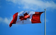 A Canadian flag flies in the wind  in Toronto, Ontario, Canada, on July 25, 2016.  (Vaughn Ridley/Getty Images/JTA)