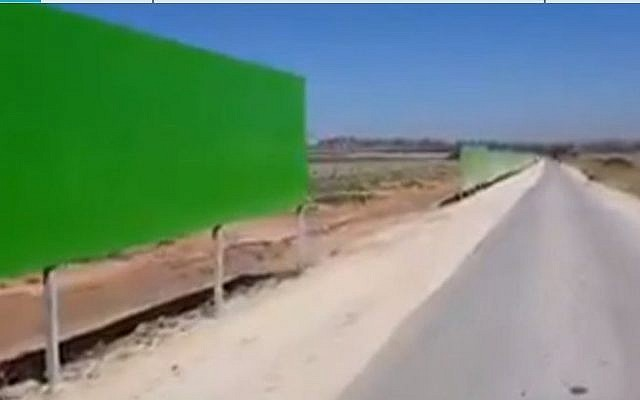 A section of the new protective barrier erected on roads bordering Gaza to protect Israeli drivers and farmers from bullets and missiles. (Channel 12 screen capture)