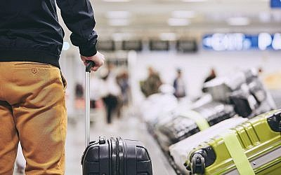 Illustrative image of a man at an airport/travel (Chalabala; iStock by Getty Images)