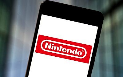 The Nintendo logo is seen displayed on a smartphone. (Photo Illustration by Rafael Henrique/SOPA Images/LightRocket via Getty Images and JTA)