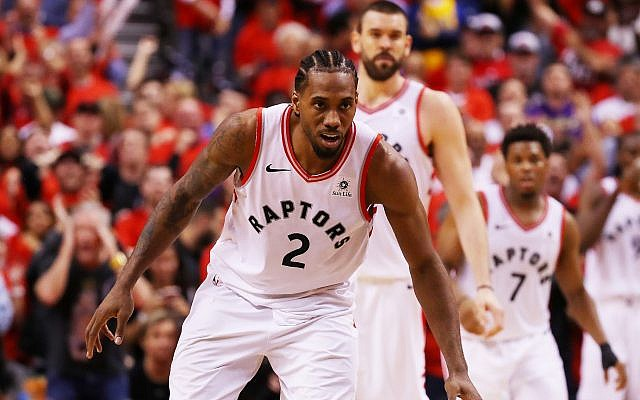 Toronto Raptors star Kawhi Leonard, in front of teammates Marc Gasol (second from left) and Kyle Lowry, reacts during game five of the 2019 NBA Finals against the Golden State Warriors at Scotiabank Arena in Toronto, June 10, 2019. (Gregory Shamus/Getty Images)