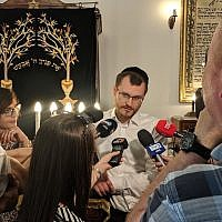 Rabbi Dawid Szychowski telling journalists about the Festival of Tranquility that he launched in Lodz, Poland, on June 8, 2019. (Courtesy Shvei Israel/via JTA)