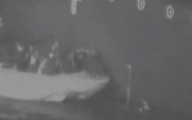 Screen grab from footage released by US Department of Defense on June 15, 2019 which it says shows Iran removing unexploded mine from Gulf tanker (Department of Defense via CNN)