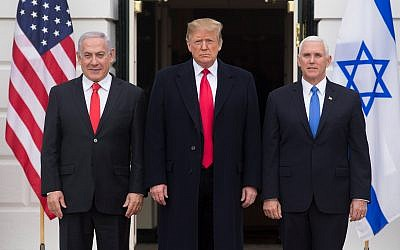 US President Donald Trump is flanked by Israeli Prime Minister Benjamin Netanyahu, left, and US Vice President Mike Pence in Washington, March 25, 2019. (Michael Reynolds – Pool/Getty Images via JTA)