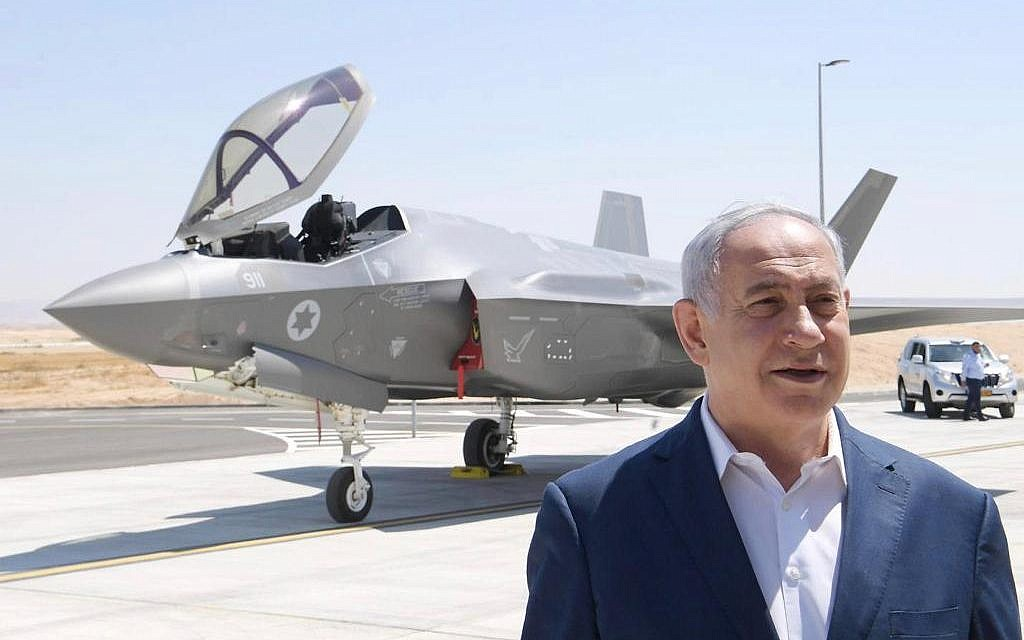 Prime Minister Benjamin Netanyahu stands in front of an F-35 fighter jet at the Israeli Air Force's Nevatim base in southern Israel, undated (Amos Ben Gershom/GPO)