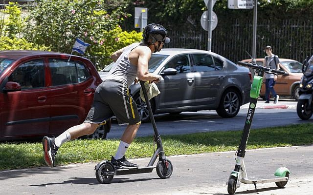 A man rides an electric scooter in the streets of Tel Aviv on May 30, 2019. (Jack Guez/AFP)