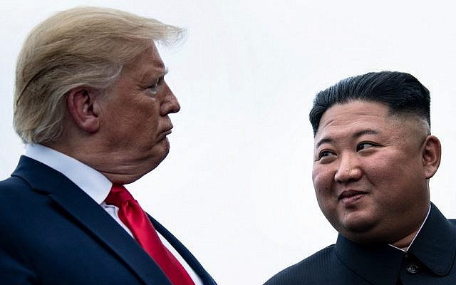 US President Donald Trump and North Korea's leader Kim Jong Un talk before a meeting in the Demilitarized Zone (DMZ) on June 30, 2019, in Panmunjom, Korea. (Brendan Smialowski / AFP)
