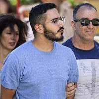 The so-called 'Tinder swindler,' center, an Israeli man described in news reports as 28-year-old Simon Hayut, is expelled from the city of Athens, Greece, on July 1, 2019. (Tore KRISTIANSEN/various sources/AFP)