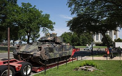 A Bradley Fighting Vehicle is seen in front of the Lincoln Memorial (back right) ahead of the 'Salute to America' Fourth of July event with US President Donald Trump at the Lincoln Memorial on the National Mall in Washington, DC, on July 3, 2019. (Alastair Pike/AFP)