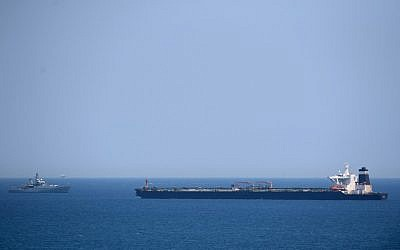 A British Royal Navy ship (L) patrols near supertanker Grace 1, which is suspected of carrying Iranian crude oil to Syria in violation of EU sanctions, after it was detained off the coast of Gibraltar on July 4, 2019. (Jorge Guerrero/AFP)