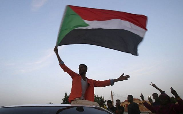 Sudanese protesters celebrate in the streets of Khartoum after ruling generals and protest leaders announced they have reached an agreement on the disputed issue of a new governing body on July 5, 2019. (Ashraf Shazly/AFP)