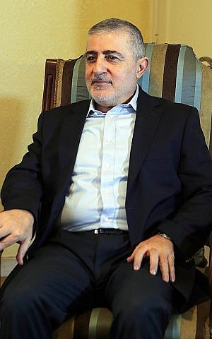 This file photo taken on April 12, 2018 shows senior Hezbollah security official Wafiq Safa at his office in the Lebanese capital Beirut. (AFP)
