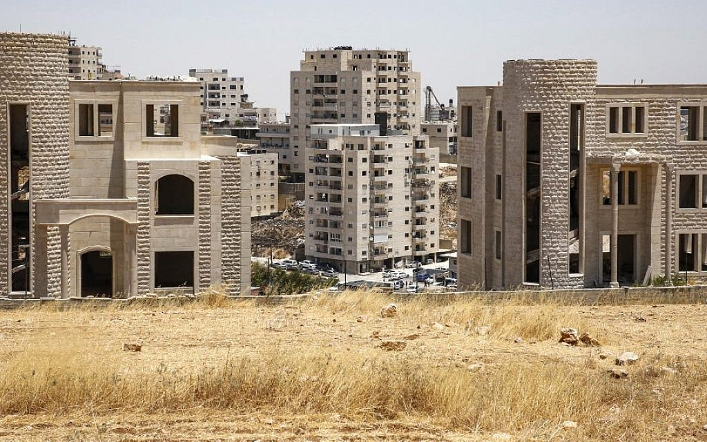 A picture from the Palestinian village of Beit Sahur in the West Bank shows Palestinian buildings which have been issued demolition notices, in the Sur Baher neighborhood of East Jerusalem, July 11, 2019. (Hazem Bader/AFP)