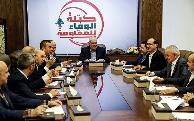 Muhammad Raad (C), Lebanese MP for the Shiite Hezbollah terror group, holds a meeting of the party's parliamentary bloc in the capital Beirut's southern suburb of Haret Hreik on July 11, 2019, including MPs Amin Sherri (4th-L), Hassan Fadlallah (5th-L), Ali Ammar (6th-L), and Industry Minister Hussein Haj Hassan (4th-R). (Joseph Eid/AFP)