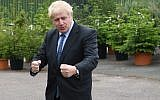 Conservative MP and leadership contender Boris Johnson gestures during a leadership campaign visit to a nursery in Braintree, southeast England on July 13, 2019. (NEIL HALL / POOL / AFP)