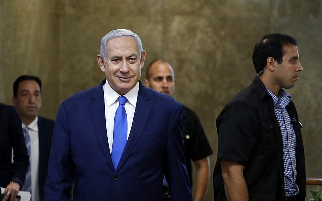 Prime Minister Benjamin Netanyahu arrives to the weekly cabinet meeting in Jerusalem on July 14, 2019. (RONEN ZVULUN / POOL / AFP)