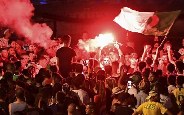 Algeria supporters celebrate after Algeria won the 2019 Africa Cup of Nations (CAN) semi-final soccer match against Nigeria, at the old harbor in Marseille, southern France, on July 14, 2019. (Boris HORVAT/AFP)