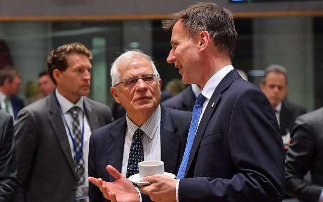 Spain's Minister of Foreign Affairs Josep Borrell (L) welcomes Britain's Foreign Secretary Jeremy Hunt (R) during a foreign ministers' meeting at the EU headquarters in Brussels on July 15, 2019. (John Thys/AFP)