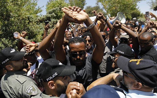 Ethiopian-Israelis protest outside the Knesset in Jerusalem on July 15, 2019, after the release of a police officer who shot and killed a young man of Ethiopian origin in Haifa on June 30. (Menahem Kahana/AFP)