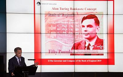 Mark Carney, governor of the Bank of England, speaks in front of the concept design for the new Bank of England 50 pound banknote, featuring mathematician and scientist Alan Turing, during the presentation at the Science and Industry Museum in Manchester, north-west England on July 15, 2019. (OLI SCARFF / AFP)