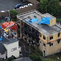 This aerial view shows the rescue and recover scene after a fire at an animation company building killed at least 33 people in Kyoto on July 18, 2019. (Photo by JIJI PRESS / JIJI PRESS / AFP)