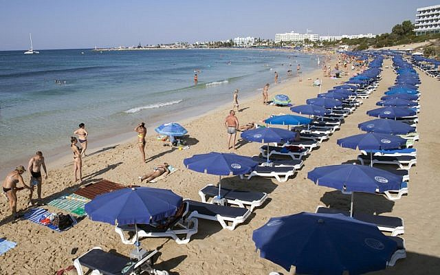 In this file photo taken on September 7, 2017, tourists sunbathe at the beach in the resort town of Ayia Napa in southeastern Cyprus. (Florian Choblet/AFP)