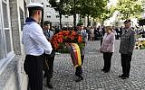 German Chancellor Angela Merkel presents a wreath of flowers during the memorial ceremony for the 75th anniversary of the attempted assassination of Adolf Hitler in Berlin, on July 20, 2019. (John MACDOUGALL / AFP)