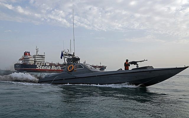 A picture taken on July 21, 2019, shows Iranian Revolutionary Guards patrolling around the British-flagged tanker Stena Impero as it's anchored off the Iranian port city of Bandar Abbas. (Hasan Shirvani / MIZAN NEWS AGENCY / AFP)
