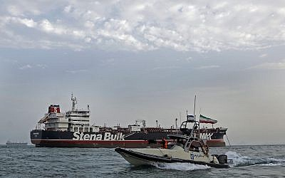 Iranian Revolutionary Guards patrolling around the British-flagged tanker Stena Impero as it was anchored off the Iranian port city of Bandar Abbas, on July 21, 2019. (Hasan Shirvani/ MIZAN NEWS AGENCY/AFP)
