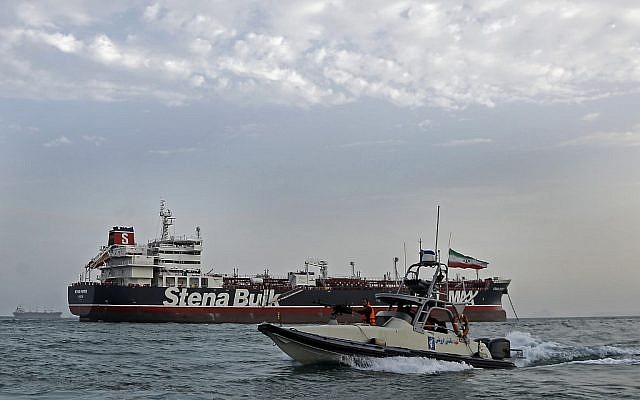 A picture taken on July 21, 2019, shows an Islamic Revolutionary Guard Corps ship patrolling around the British-flagged tanker Stena Impero, as it's anchored off the Iranian port city of Bandar Abbas. (Hasan Shirvani/Mizan News Agency/AFP)