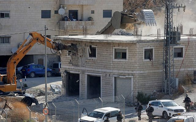 This picture taken July 22, 2019 shows Israeli security forces razing a Palestinian building under construction in the Wadi al-Hummus area adjacent to the East Jerusalem Palestinian village of Sur Baher. (Hazem Bader/AFP)
