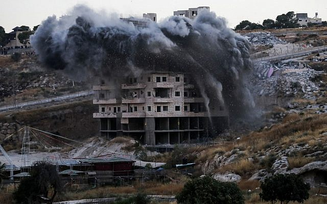 This picture taken on July 22, 2019, shows the demolition of a Palestinian building that was under construction in the East Jerusalem neighborhood of Sur Baher. (Ahmad GHARABLI / AFP)