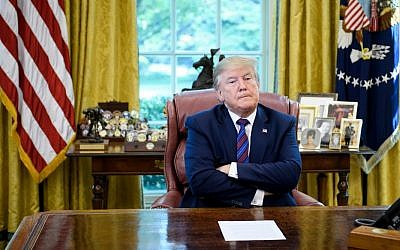 US President Donald Trump pauses while announcing an agreement with Guatemala regarding people seeking asylum in the Oval Office of the White House July 26, 2019, in Washington, DC. (Brendan Smialowski / AFP)