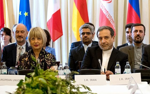 Abbas Araghchi (Center R), political deputy at the Ministry of Foreign Affairs of Iran, and Helga Schmid (Center L), Secretary General of the EU's External Action Service (EEAS), take part in a meeting of the Joint Commission of the Joint Comprehensive Plan of Action (JCPOA) attended by China, France, Germany, Russia,the UK and Iran on July 28, 2019 at the Palais Coburg in Vienna, Austria. (ALEX HALADA / AFP)