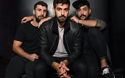 In this file photo taken on November 1, 2017 (L-R) Musicians Haig Papazian, Carl Gerges and Hamed Sinno of Mashrou' Leila pose for a picture in New York. (Angela Weiss/AFP)