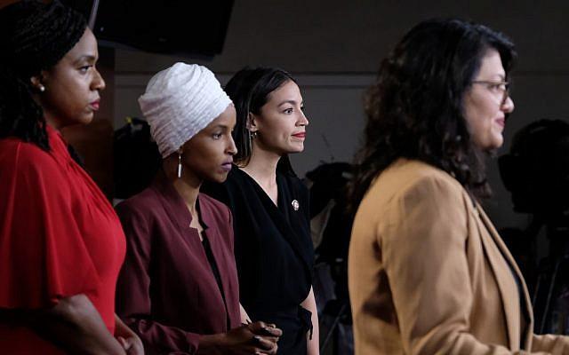 WASHINGTON, DC - JULY 15: (Left to right) US Reps. Ayanna Pressley (Democrat-Massachusetts), Ilhan Omar (Democrat-Minnesota) and Alexandria Ocasio-Cortez (Democrat-New York) listen as Rep. Rashida Tlaib (Democrat-Michigan) pauses while speaking at a news conference at the US Capitol in Washington, D.C. on July 15, 2019. (Alex Wroblewski/Getty Images/AFP)