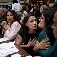 Rep. Alexandria Ocasio-Cortez (D-NY) (C) confers with U.S. Rep. Rashida Tlaib, (D-MI) (2nd R) and Rep. Ayanna S. Pressley (D-MA) (R) during a House Oversight and Reform Committee hearing July 12, 2019 in Washington, DC. (Win McNamee/Getty Images/AFP)