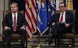 US.Secretary of the Treasury Steven Mnuchin and FBI Director Christopher Wray wait to be introduced during an Combating Anti-Semitism Summit at the Justice Department July 15, 2019 in Washington, DC.  (Alex Wong/Getty Images/AFP)